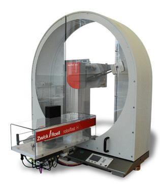 roboTest H pendulum impact tester with automated specimen loading cartridge.