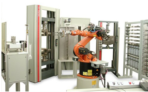 A roboTest R (Polar) system supporting high throughput tensile tests on metal specimens.