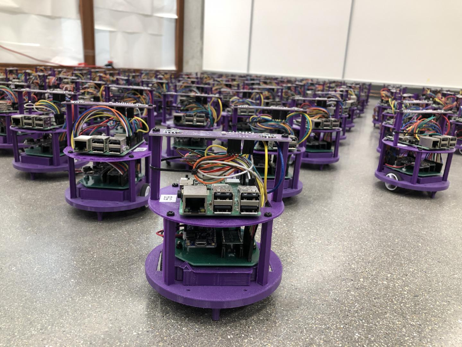 One hundred small robots line up in the laboratory