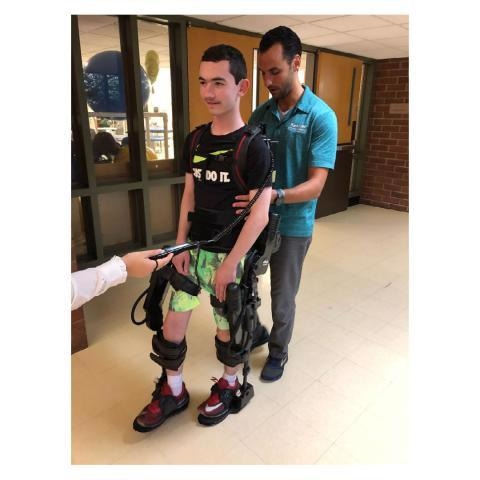 A study participant undergoing gait training in the EksoGT administered by a licensed physical therapist.