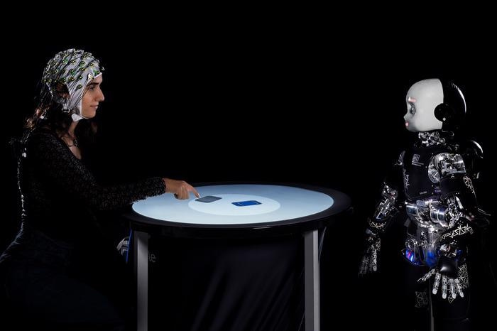 Research Reveals Delay in Human Brain Process While Gazing at a Robot.