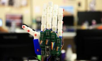 Humanoid Programmed to Communicate with Deaf People Through Sign Language